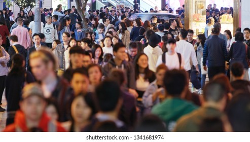 Causeway Bay, Hong Kong -22 February 2019: Crowded of People cross the road at night
