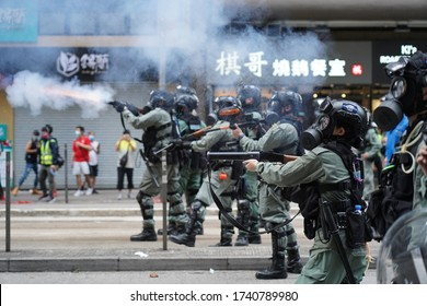 Causeway Bay, Hong Kong - 24 May 2020: Riot police shot tear gas canisters to disperse protestors on the road when protestors came out to oppose new national security law from Beijing.