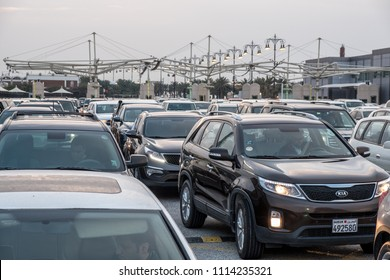 CAUSEWAY ISLAND, BAHRAIN - 25 FEBRUARY, 2017: Cars bound for Saudi Arabia wait in line at dawn on a congested morning at Bahrain passport control.