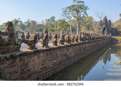 Causeway to the South Gate of Angkor Thom with 54 Gods and 54 demons pulling on a giant snake leading to  the city built by King Jayavarman VII 1190-1210