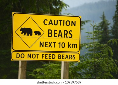Caution Bears Next 10km - Do Not Feed Bears. Road Side Yellow Sign in British Columbia, Canada.