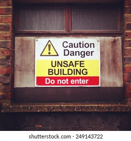 caution danger unsafe building sign do not enter derelict stock, photo, photograph, picture, image