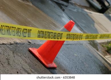 """CAUTION DO NOT CROSS"" caution tape"