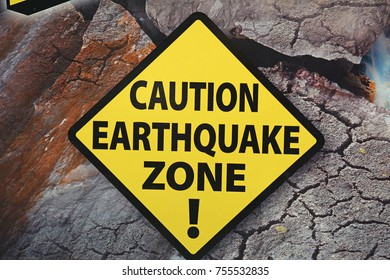Caution Earthquake Zone Sign on Cracked Rock Background