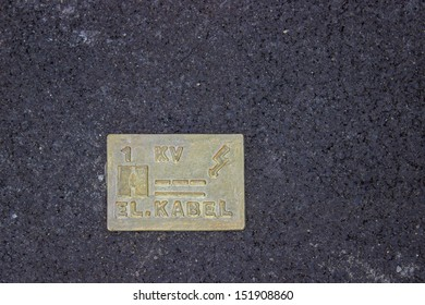 Caution electric cable below. Cable Identification Tile for the protection and location of electric cables.