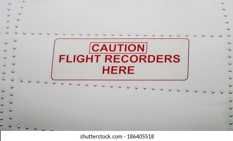 Caution Flight Recorders Here. Black box from the side of commercial airplane