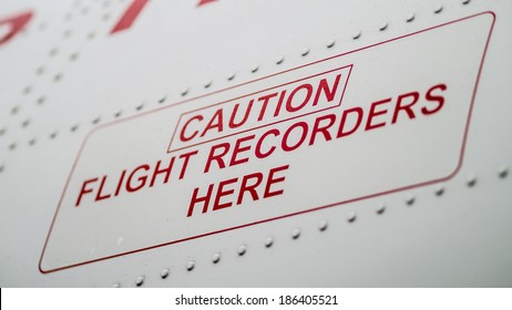 Caution Flight Recorders Here. From the side of commercial airplane