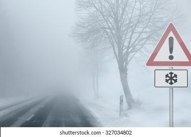Caution - Foggy Winter Road