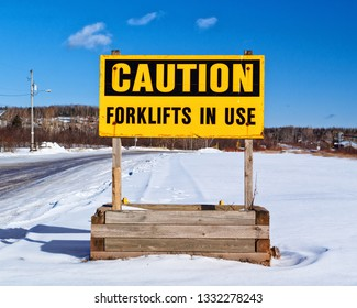 Caution, forklifts in use sign during winter.