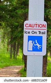 A caution, ice on trail sign.
