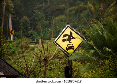 Caution label Old woman witch figurine with car in garden outdoor on forest mountain at pai city hill valley in Mae Hong Son, Thailand