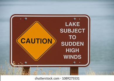 caution lake subject to high winds sign on the shore of Mono Lake