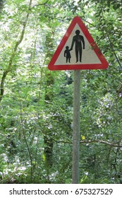 Caution Pedestrians - a sign on a forest road near Looe in Cornwall