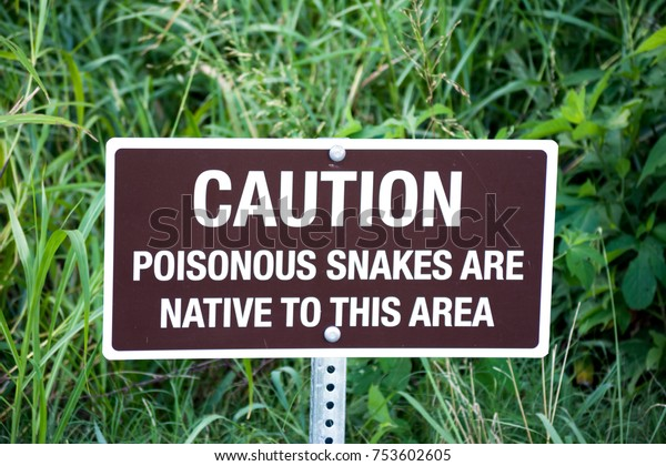 CAUTION Poisonous Snakes Are Native To This Area sign in high grass
