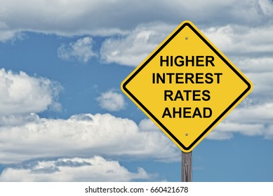 Caution Sign Blue Sky Background - Higher Interest Rates Ahead