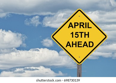 Caution Sign Blue Sky Background - April 15th Ahead