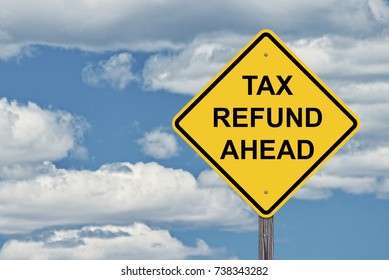 Caution Sign Tax Refund Ahead -  Blue Sky Background