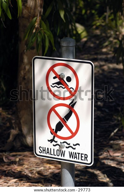 Caution sign,shallow water.