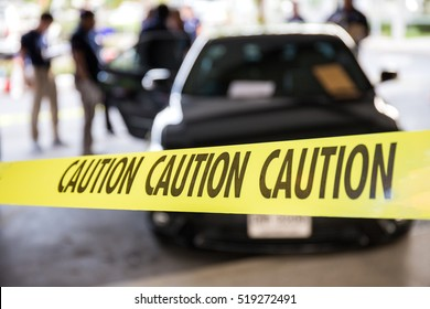 caution tape or police line protect vehicle in crime scene investigation training in academy with blurred law enforcement background