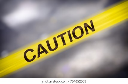 Caution tape sign with blurred background