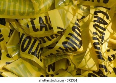 caution tape in trash can
