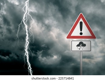 Caution - Thunderstorm Ahead - A dark cloudy sky with a lightning bolt and a warning sign in the foreground  - computer generated image