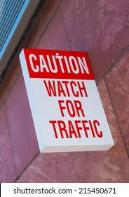 Caution, Watch For Traffic Wall Sign. Warning Sign