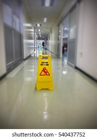 Caution wet floor or cleaning in progress. A yellow sign warning area is being cleaned.