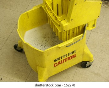 Caution Wet Floor Sign and Mop Bucket