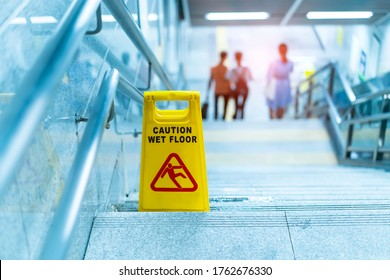 """""""Caution wet floor"""" sign in stairs"""