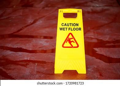 Caution wet floor signboard indoors