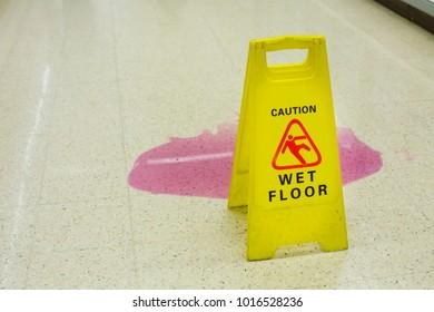 Caution wet floor signs in the supermarket.