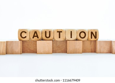 Caution word on wooden cubes