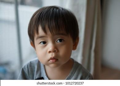 Cautious Asian boy