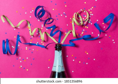 Cava bottle, confetti and celebration streamers