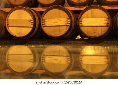 Cava wine barrels reflected in glass