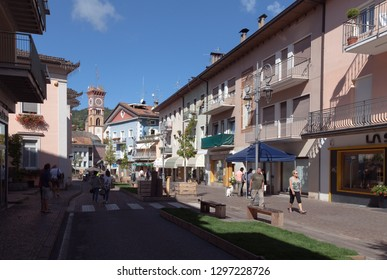 CAVALESE, ITALY ON SEPTEMBER 15. Street view from the center of the city on September 15, 2018 in Cavalese, Italy. Unidentified people. Store and flats.
