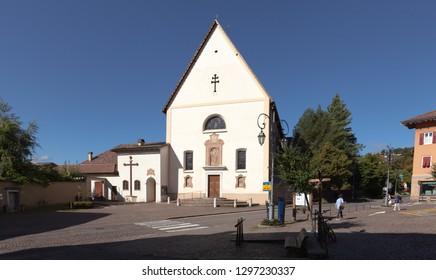 CAVALESE, ITALY ON SEPTEMBER 15. View of the Chiesa di San Vigilio, Convento Padri Francescani on September 15, 2018 in Cavalese, Italy. Unidentified people.