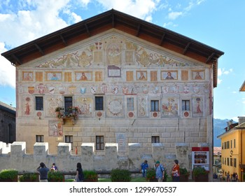 "Cavalese, Trentino, Italy, 14/8/16: The facade of the palace of the ""Magnifica Comunità"" at the centre of Cavalese. It was the residence of the Prince-bishops of Trento.  The facade with frescoes"