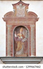 Cavalese, Trentino, Italy, 16 August 2016: Mural over the entrance of the Fransiscans' Church (Chiesa dei Frati Francescani)