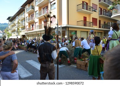 """Cavalese, Trentino, Italy, Aug 14, 2016: """"Su par Vila"""" traditional street festival, recreating the story and old game of """"bear hunting""""."""