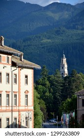 Cavalese, Trentino, Italy, Aug 14 2016. View from the village, with the bell tower of the church of the Assumption of Mary in the distance