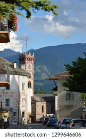 Cavalese, Trentino, Italy, Aug 14 2016. View of the main road of the  village, with the bell tower of the church of the bell tower of the Church of st Sebastian