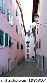 Cavalese, Trentino, Italy, Aug 14 2016. Narrow road with pink building