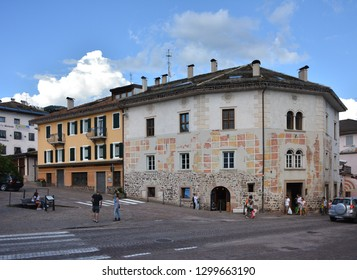 Cavalese, Trentino, Italy, Aug 14 2016. View in the main road of the village, with old building with mural decorations