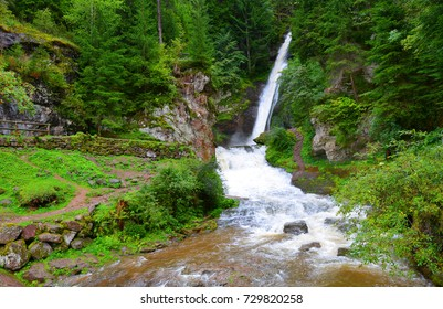 Cavalese waterfall in a valley Val di Fiemme.South Tyrol,Italy.