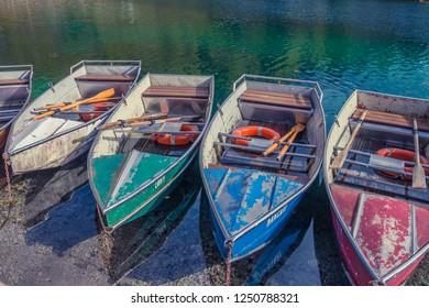 CAVAZZO LAKE, FRIULI VENEZIA GIULIA, ITALY - november, 2017: beautiful autumn view Cavazzo lake in Friuli Venezia Giulia, Italy. small boats  wait for summer in lake shore