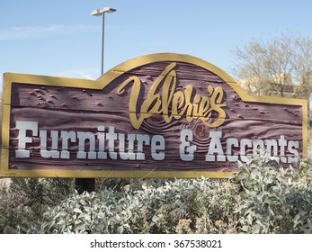 Cave Creek, Arizona, USA - 14.01.2016: logo of Valerie's Furniture & Accents in old west American style town of Cave Creek, Arizona