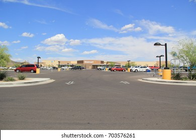 CAVE CREEK, AZ - JULY 27: Cars in the parking lot outside of the Walmart retail super store in Cave Creek, Arizona on July 27, 2017.