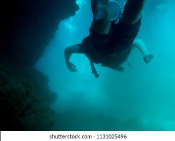 Cave Diving at the Great Barrier Reef, Australia in murky water